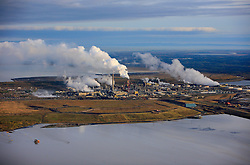 CANADA ALBERTA FORT MCMURRAY 28SEP09 - Aerial view of Syncrude upgrader in the Boreal forest north of Fort McMurray, northern Alberta, Canada...The tar sand deposits lie under 141,000 square kilometres of sparsely populated boreal forest and muskeg and contain about 1.7 trillion barrels of bitumen in-place, comparable in magnitude to the world's total proven reserves of conventional petroleum. ..Current projections state that production will  grow from 1.2 million barrels per day (190,000 m³/d) in 2008 to 3.3 million barrels per day (520,000 m³/d) in 2020 which would place Canada among the four or five largest oil-producing countries in the world...The industry has brought wealth and an economic boom to the region but also created an environmental disaster downstream from the Athabasca river, polluting the lakes where water and fish are contaminated. The native Indian tribes of the Mikisew, Cree, Dene and other smaller First Nations are seeing their natural habitat destroyed and are largely powerless to stop or slow down the rapid expansion of the oil sands development, Canada's number one economic driver...jre/Photo by Jiri Rezac / GREENPEACE..© Jiri Rezac 2009