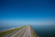 De Afsluitdijk bij Den Oever. Het is dit jaar tachtig jaar geleden dat de Afsluitdijk werd voltooid en de Waddenzee (rechts op de foto) werd afgesloten van wat nu het IJsselmeer heet.<br /> <br /> The Afsluitdijk near Den Oever. In 1932, the gap between the Wadden Sea and the former Zuiderzee closed by the Afsluitdijk. Now it is a major thoroughfare between Friesland and North Holland and it separates the Wadden Sea from the IJsselmeer.