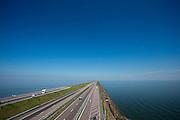 De Afsluitdijk bij Den Oever. Het is dit jaar tachtig jaar geleden dat de Afsluitdijk werd voltooid en de Waddenzee (rechts op de foto) werd afgesloten van wat nu het IJsselmeer heet.<br /> <br /> The Afsluitdijk near Den Oever. In 1932, the gap between the Wadden Sea and the former Zuiderzee closed by the Afsluitdijk. Now it is a major thoroughfare between Friesland and North Holland and it separates the Wadden Sea from the IJsselmeer.