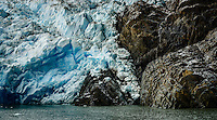 The glacial ice crumbles as it brushes against the rock. Glacier Grey in Torres del Paine National Park, Chile.