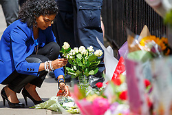 © Licensed to London News Pictures. 07/07/2015. London, UK. Members of the public pay their respects to 7/7 London bombings victims on the 10th anniversary of 7/7 London bombings in Tavistock Square on Tuesday, July 7, 2015. Photo credit: Tolga Akmen/LNP