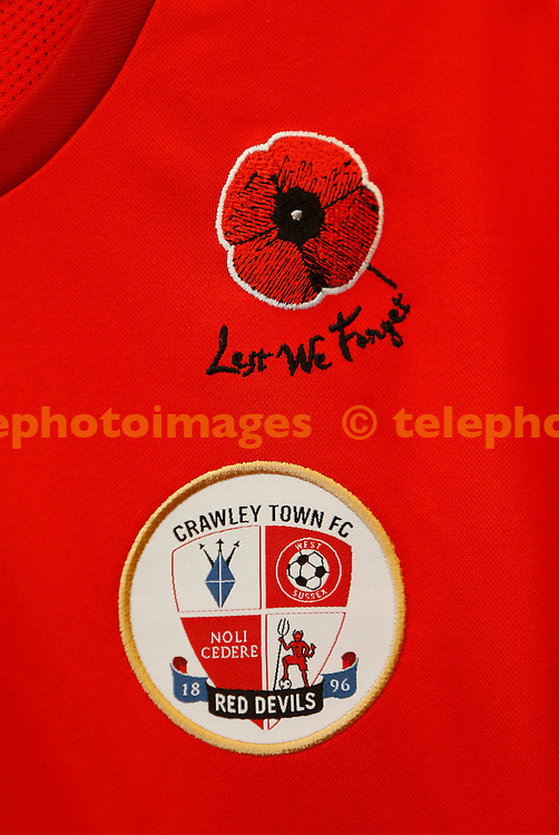 """""""Lest we forget"""" limited edition shirt seen before the Johnstone's Paint match between between<br /> Crawley Town and Gillingham at the Checkatrade.com Stadium in Crawley. November 11, 2014.<br /> James Boardman / TELEPHOTO IMAGES 07967642437"""