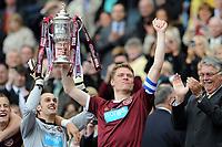 Football - Scottish FA Cup Final - Hibernian vs. Hearts<br /> Marius Zaliukas (Hearts) lifts the trophy at Hampden Park.