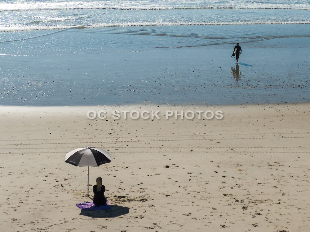 Surfer on the Beach at Low Tide