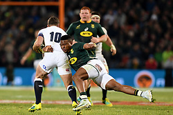 Bloemfontein. 16.06.18.  Aphiwe Dyantyi launches a fierce attack on his English opponent George Ford during the second rugby test between South Africa and England at Toyota Stadium in Bloemfontein. Photographer: Louis Botha/African News Agency (ANA)