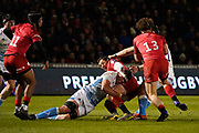 Sale Sharks flanker Jono Ross tackles  Saracens fly-half Alex Goode during a Premiership Rugby Cup Semi Final  won by Sale 28-7, Friday Feb. 7, 2020, in Eccles, United Kingdom. (Steve Flynn/Image of Sport)