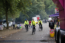 © Licensed to London News Pictures . 12/08/2018. Manchester , UK . PCSOs on bicycles in Alexandra Park . The second day of the annual Caribbean Carnival in Alexandra Park in Moss Side , celebrating music , food and Afro-Caribbean culture . A nearby shooting overnight lead to at least ten people injured . Ten people are in hospital . Photo credit : Joel Goodman/LNP