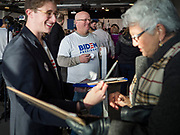 23 NOVEMBER 2019 - DES MOINES, IOWA: JOHN BUSH (far right), from Des Moines, hands out Biden stickers at a campaign event for former Vice President Joe Biden in Des Moines Saturday. Vice President Biden announced that Tom Vilsack, the former Democratic governor of Iowa, endorsed him. Biden and Vilsack appeared with their wives at an event in Des Moines. Iowa hosts the first presidential selection event of the 2020 election cycle. The Iowa caucuses are on February 3, 2020.                   PHOTO BY JACK KURTZ