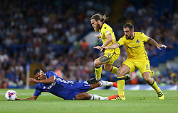23 August 2016 - EFL Cup - Chelsea v Bristol Rovers<br /> Ruben Loftus-Cheek of Chelsea is tackled by Stuart Sinclair and Peter Hartley of Bristol Rovers<br /> Photo: Charlotte Wilson