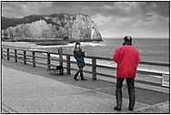 DAY TRIPPER- Etretat - selective colour photo art by Paul Williams of tourists posing for photos in fromt of thw white arched cliffs of the Normandy coast .<br /> <br /> Visit our REPORTAGE & STREET PEOPLE PHOTO ART PRINT COLLECTIONS for more wall art photos to browse https://funkystock.photoshelter.com/gallery-collection/People-Photo-art-Prints-by-Photographer-Paul-Williams/C0000g1LA1LacMD8