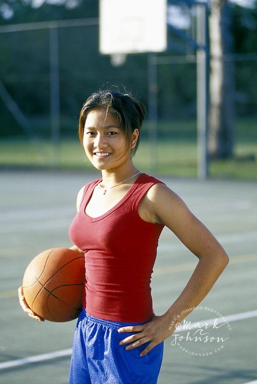 Filipina-Australian teen girl on basketball court, Brisbane, Queensland, Australia