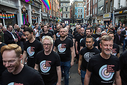 London, UK. 30th April 2019. London Gay Men's Chorus joins survivors of the Admiral Duncan bombing, families and friends of the victims and the LGBTQ community outside the Admiral Duncan pub in Old Compton Street, Soho, to mark 20 years since the attack. Three people were killed and 79 injured when a bomb packed with up to 1,500 four-inch nails was detonated by a neo-Nazi at the Admiral Duncan on 30th April 1999.
