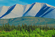 Dempster Highway, gravel road, at sunset in Ogilvie Mountains<br /> Dempster Highway<br /> Yukon<br /> Canada