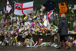 © licensed to London News Pictures. London, UK 28/05/2013. Members of the public lay flowers and pay their respects at the scene where Drummer Lee Rigby was murdered by two men in Woolwich town centre in what is being described as a terrorist attack. Photo credit: Tolga Akmen/LNP