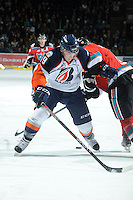 KELOWNA, CANADA, OCTOBER 29: Brendan Ranford #19 of the Kamloops Blazers is checked as he skates on the ice as the Kamloops Blazers visit the Kelowna Rockets  on October 29, 2011 at Prospera Place in Kelowna, British Columbia, Canada (Photo by Marissa Baecker/Shoot the Breeze) *** Local Caption *** Brendan Ranford;