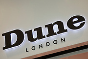 Sign for the high street clothing brand Dune London in Birmingham, United Kingdom.