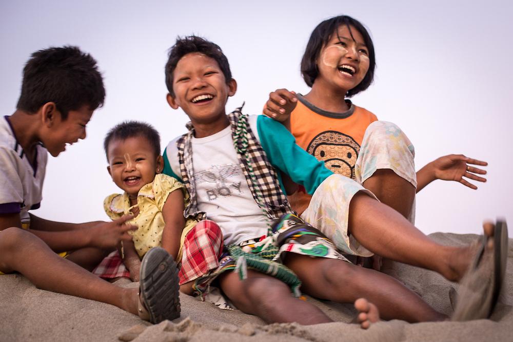 Myanmar. Burmese Kids sharing happiness.<br /> Photo by Lorenz Berna