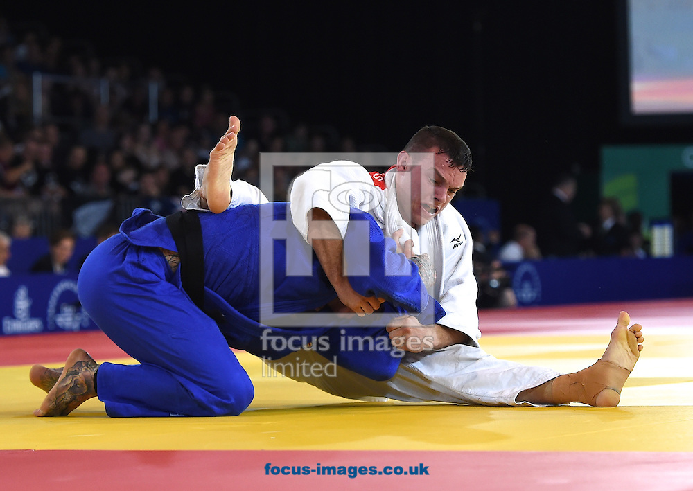 Danny Williams ENG (blue) and Arnie Dickins AUS during the mens 73k on day two of the judo at the  SECC Precinct, Glasgow<br /> Picture by Alan Stanford/Focus Images Ltd +44 7915 056117<br /> 25/07/2014