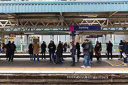 © Licensed to London News Pictures. 21/02/2019. London, UK.  People wait for trains at Barking Station this morning, which has now reopened. A person was reportedly stabbed on an underground train at Barking Station last night, with the suspect fleeing along the platform. Photo credit: Vickie Flores/LNP