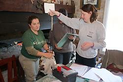 Estela, Miriam & CLaudia Demonstrating Weighing Proceedure