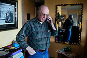Dean Baker, 72, owner of the largest ranch in Snake Valley, is talking on the phone inside his home near Baker, Utah, USA. Although opposing South Nevada Water Authority (SNWA) 300-mile water pipeline project, he is one of the very few inhabitants of Snake Valley that is supporting Utah Governor Gary R. Herbert to sign a legal agreement between Utah and Nevada. This document should protect their future rights and the local environment, but would also allow for the beginning of the pipeline construction: many people fear that once pumping water, it will not be easily stopped, even if breaching any of the points outlined within the agreement.