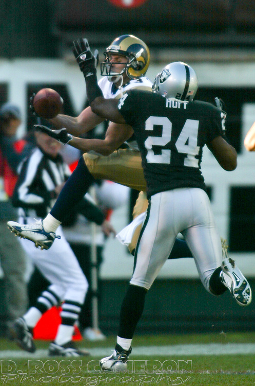 Oakland Raiders defensive back Michael Huff (24) breaks up a deep pass intended for St. Louis Rams' Kevin Curtis (83) during the third quarter of an NFL football game, Sunday, Dec. 17, 2006 at McAfee Coliseum in Oakland, Calif. The Rams won, 20-0. (D. Ross Cameron/The Oakland Tribune)