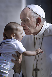 May 10, 2017 - Vatican - Pope Francis- Weekly General Audience in St Peter Square - Pope Francis kisses a baby as he arrives to lead his Wednesday general audience in Saint Peters square. (Credit Image: © Donatella Giagnori/Eidon Press via ZUMA Press)