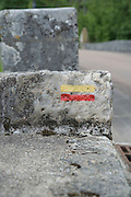 markings on a stone indicating direction on a rambling path France