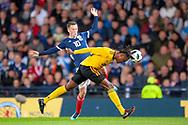 Dedryck Boyata (#20) of Belgium heads clear from Celtic team mate Callum McGregor (#10) of Scotland during the International Friendly match between Scotland and Belgium at Hampden Park, Glasgow, United Kingdom on 7 September 2018.