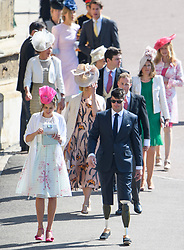 © Licensed to London News Pictures. 19/05/2018. London, UK. Guests arrive at The wedding of Prince Harry, The Duke of Sussex to Meghan Markle, The Duchess of Sussex, at St George's Chapel in Windsor. Photo credit: Ben Cawthra/LNP