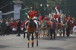 August 17, 2017 - Jakarta, Indonesia - The marching band team from the Indonesian military and police along with people with traditional dresses escorted the horse cart carrying the Bendera Pusaka (Heirloom Flag) from National Monument to the State Palace for Indonesia's 72nd Independence Day ceremony in Jakarta. Bendera Pusaka is the first Indonesian national flag which is sewn directly by Fatmawati, the wife of Indonesia's first President Soekarno. (Credit Image: © Aditya Irawan/NurPhoto via ZUMA Press)