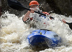 """Garrett Bentley of St. Louis, Missouri races in the K1 Men's Novice/Expert class on the slalom course of the 45th Annual Missouri Whitewater Championships. Bentley placed third in the class and second in the downriver K1 Men's Plastic (under 30 class). The Missouri Whitewater Championships, held on the St. Francis River at the Millstream Gardens Conservation Area, is the oldest regional whitewater slalom race in the United States. Heavy rain in the days prior to the competition sent water levels on the St. Francis River to some of the highest heights that the race has ever been run. Only expert classes were run on the flood level race course.Novices who chose to race were re-classified as """"novice experts"""" to recognize their achievements."""