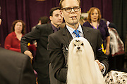 Ta-Jon's Pawsitively Pawparazzi, a Maltese, and his handler wait to go into the ring in the finals of the 137th annual Westminster Kennel Club Dog Show.