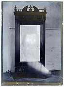 early 1900s product photo of large clothing cabinet closet with mirror