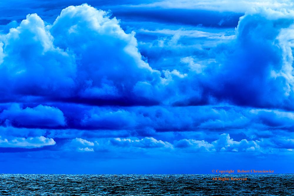 Thai Blue: Blue storm clouds hover over a rising blue Pacific Ocean, Ko Lanta – Thailand.