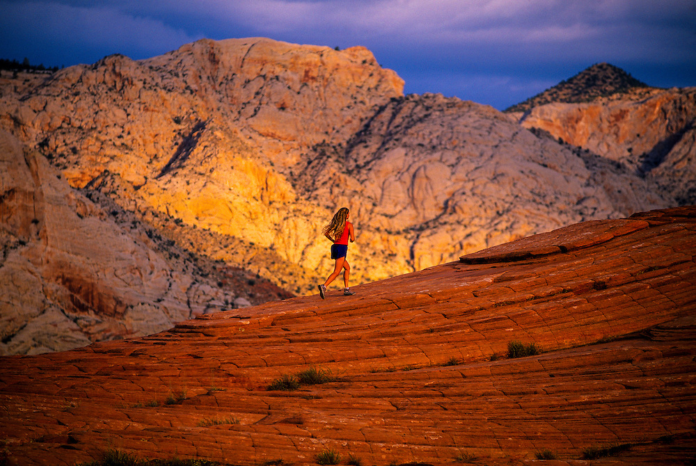 Woman running, Snow Canyon State Park, near Ivins (near St. George), Utah
