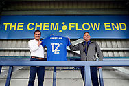 AFC Wimbledon manager Neal Ardley holding sahirt during the EFL Sky Bet League 1 match between AFC Wimbledon and Portsmouth at the Cherry Red Records Stadium, Kingston, England on 13 October 2018.