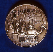 August (1862-1954) and Louis (1864-1948) Lumiere. French chemists and pioneers of cinematography. Reverse of medal commemorating 50 years of cinematography (1895-1945)  showing an audience watching a film.