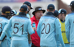 Umpire Marais Erasmus talks to the England team after Chris Woakes takes the catch to dismiss Pakistan's Imam-ul-Haq during the ICC Cricket World Cup group stage match at Trent Bridge, Nottingham.