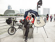 Singapore, tourist souvenir photographer at Marina Bay