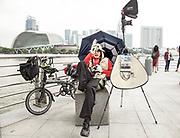 Singapore, tourist souvenir photographer at Marina Bay