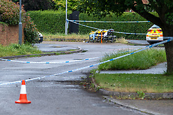 © Licensed to London News Pictures. 21/06/2021. Burnham, UK. Police tape marks out a cordon and an ambulance stretcher at the scene following the death of a man in Wyndham Crescent in Burnham on Monday 20/06/2021. Emergency services were called at approximately 13:10BST to the Buckinghamshire street following reports of an altercation involving a group of men. Shortly after this a 35-year-old man collapsed. Thames Valley Police officers and paramedics attended the scene and performed CPR on the man but he was later pronounced dead. Photo credit: Peter Manning/LNP
