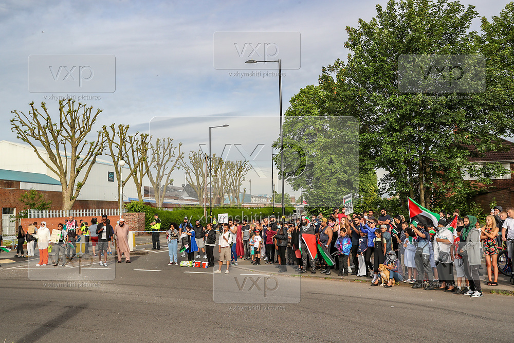 Birmingham, United Kingdom, June 14, 2021: Men, women and children are gathered to support Palestine Action activists who took over the rooftop of an American industrial factory known as Arconic in Birmingham on Monday, June 14, 2021. Some other activists used a sledgehammer to protest against the company who they say 'provided cladding for Grenfell Tower' and 'materials for Israel's fighter jets.' (Photo by Vudi Xhymshiti)