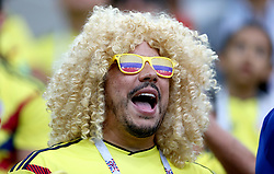 A Colombia fan in the stands impersonates Colombian former football Carlos Valderrama prior to the FIFA World Cup 2018, round of 16 match at the Spartak Stadium, Moscow.
