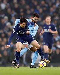 Tottenham Hotspur's Son Heung-Min (left) and Manchester City's Ilkay Gundogan battle for the ball during the Premier League match at the Etihad Stadium, Manchester.