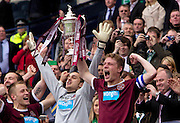 The William Hill Scottish FA Cup Final 2012 Hibernian Football Club v Heart Of Midlothian Football Club..19-05-12...Hearts captain Marius Zaliukas lifts the Scottish Cup        during the William Hill Scottish FA Cup Final 2012 between (SPL) Scottish Premier League clubs Hibernian FC and Heart Of Midlothian FC. It's the first all Edinburgh Final since 1986 which Hearts won 3-1. Hearts bid to win the trophy since their last victory in 2006, and Hibs aim to win the Scottish Cup for the first time since 1902....At The Scottish National Stadium, Hampden Park, Glasgow...Picture Mark Davison/ ProLens PhotoAgency/ PLPA.Saturday 19th May 2012.