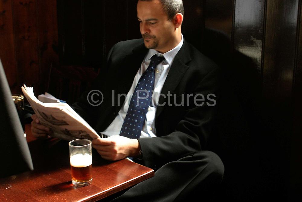 Drinker in the Old Watling Public House, London, UK