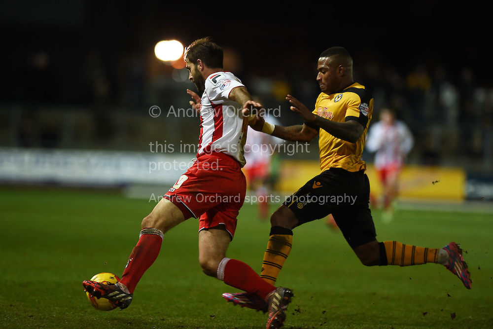 Newport county's Aaron O'Connor is sent off for this bad tackle on Stevenage player Dean Wells (l) . Skybet football league two match, Newport county v Stevenage at Rodney Parade in Newport, South Wales on Saturday 13th December 2014<br /> pic by Andrew Orchard, Andrew Orchard sports photography.