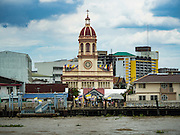 18 SEPTEMBER 2016 - BANGKOK, THAILAND:  Santa Cruz Church on the Chao Phraya River. Santa Cruz Church was establised in 1769 to serve Portuguese soldiers in the employ of King Taksin, who reestablished the Siamese (Thai) empire after the Burmese sacked the ancient Siamese capital of Ayutthaya. The church was one of the first Catholic churches in Bangkok and is one of the most historic Catholic churches in Thailand. The first sanctuary was a simple wood and thatch structure and burned down in the 1800s. The church is in its third sanctuary and was designed in a Renaissance / Neo-Classical style. It was consecrated in September, 1916. The church, located on the Chao Phraya River, serves as a landmark for central Bangkok.      PHOTO BY JACK KURTZ
