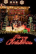 "Christmas display on 12th Avenue in Brooklyn's Dyker Height's neighbrohood. ""Merry Christmas"" is written out in lights on the front lawn."